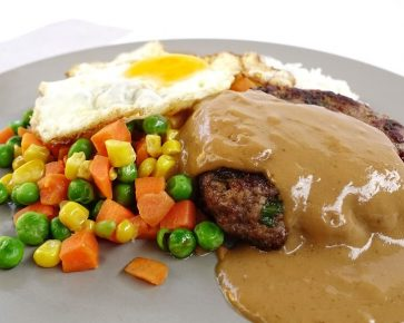 Lean beef hamburg with creamy brown gravy sauce and egg