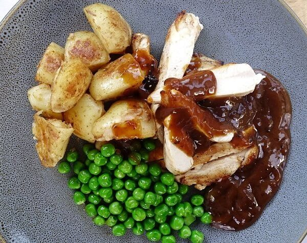 Chicken with gravy peppercorn sauce and roasted potatoes