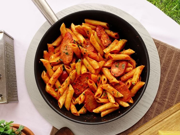 Kangaroo sausages in light creamy red sauce with penne