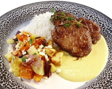 Lamb steak with mustard thyme sauce, rice and roasted vegetables