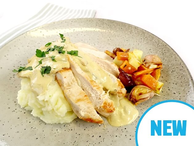 Chicken with garlic mushroom sauce, white potato mash and roasted vegetables